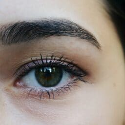 Up close shot of a woman's eye and eyebrow