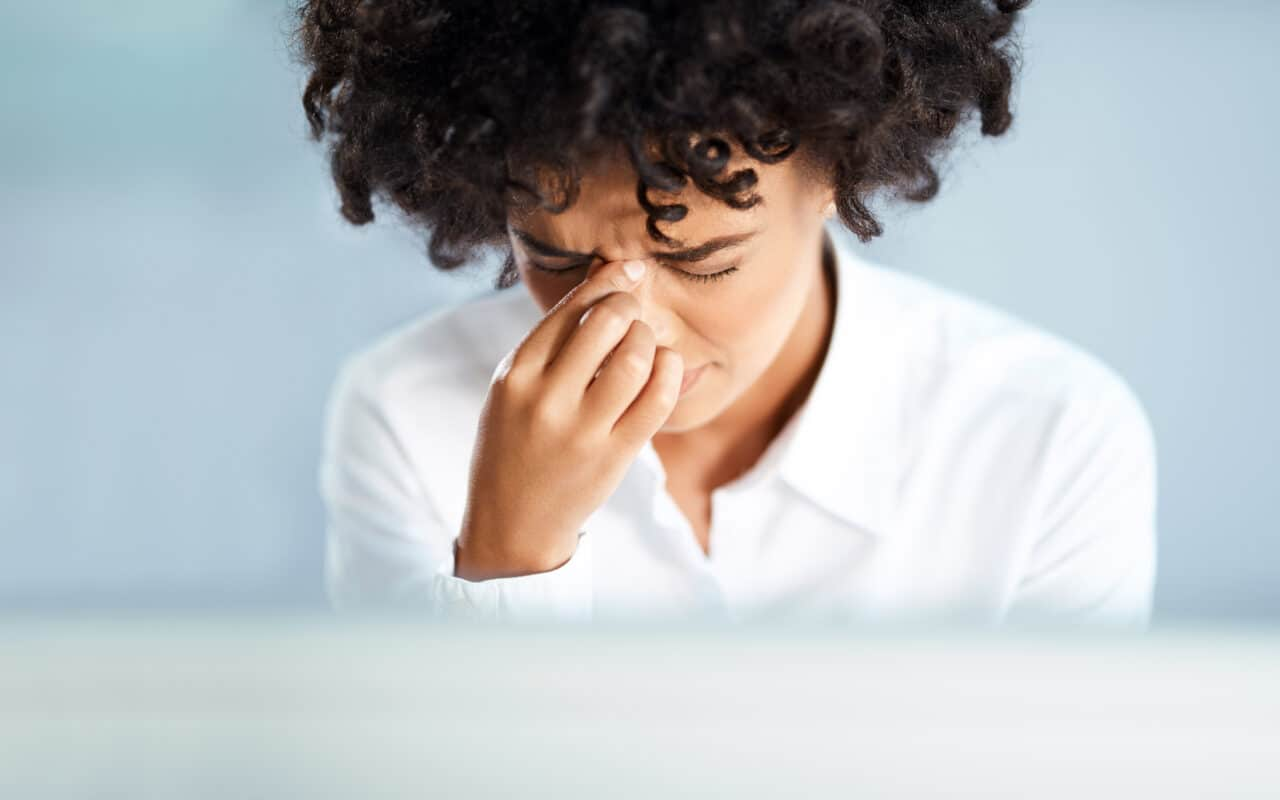 Woman looking stressed due to sinus infection.